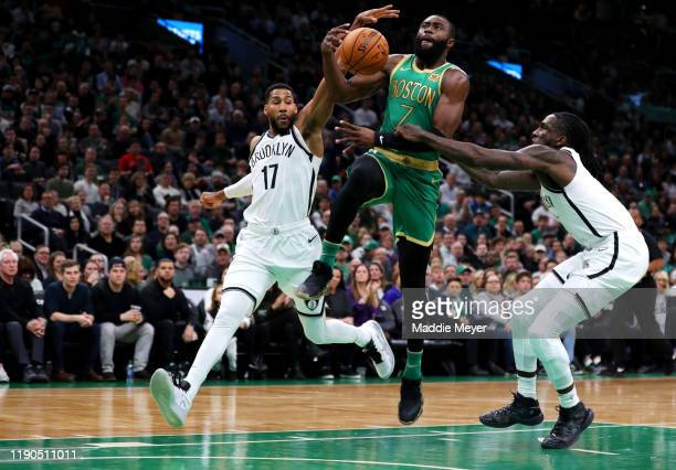 Jaylen Brown of the Boston Celtics is fouled by Garrett Temple of the Brooklyn Nets during the first half at TD Garden on November 27 2019 in Boston...