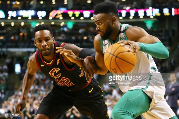 Jaylen Brown of the Boston Celtics is guarded by Jeff Green of the Cleveland Cavaliers during the second half of a game at TD Garden on February 11...