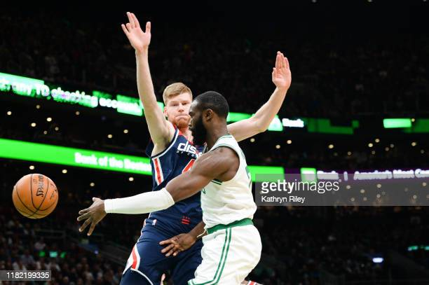 Jaylen Brown of the Boston Celtics passes against Davis Bertans of the Washington Wizards in the second half at TD Garden on November 13 2019 in...
