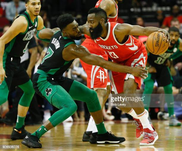 Jaylen Brown of the Boston Celtics reaches in on James Harden of the Houston Rockets in the first quarter at Toyota Center on March 3 2018 in Houston...