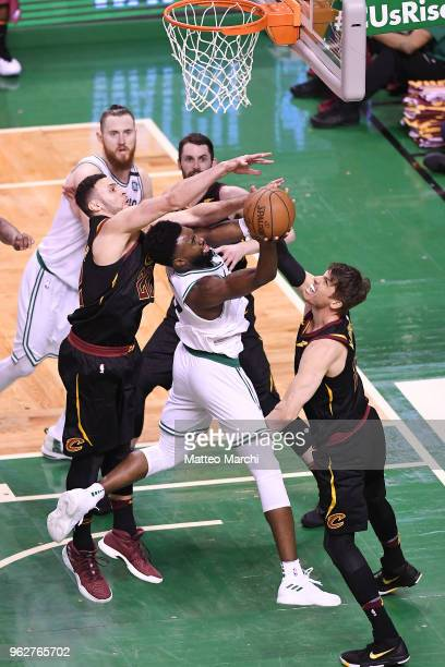 Jaylen Brown of the Boston Celtics shoots the ball against Larry Nance Jr #22 and Kyle Korver of the Cleveland Cavaliers during Game Five of the 2018...