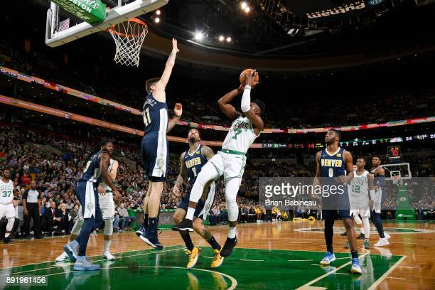 Jaylen Brown of the Boston Celtics shoots the ball against the Denver Nuggets on December 13 2017 at the TD Garden in Boston Massachusetts NOTE TO...