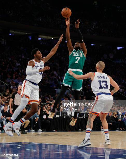 Jaylen Brown of the Boston Celtics shoots the ball as RJ Barrett of the New York Knicks and Evan Fournier defend during the second half at Madison...