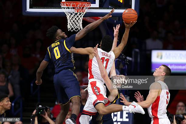 Jaylen Brown of the California Golden Bears blocks a shot by Allonzo Trier of the Arizona Wildcats during the second half of the college basketball...