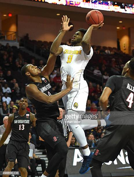 Jaylen Brown of the California Golden Bears drives to the basket against Skylar Spencer of the San Diego State Aztecs during the 2015 Continental...