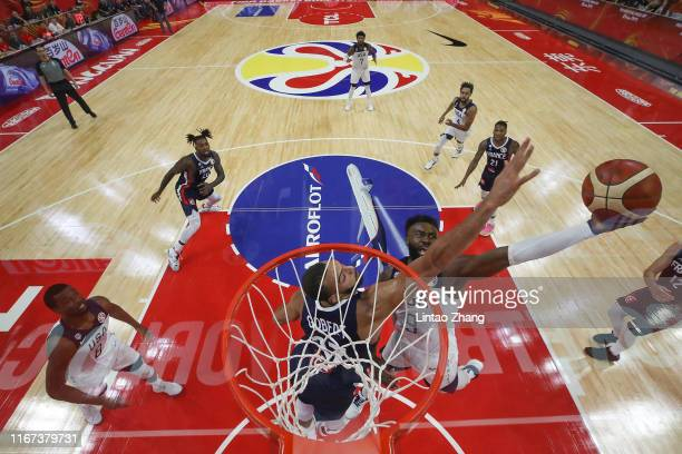 Jaylen Brown of USA in action against Rudy Gobert of France during FIBA World Cup 2019 Quarter-finals match between USA and France at Dongguan...