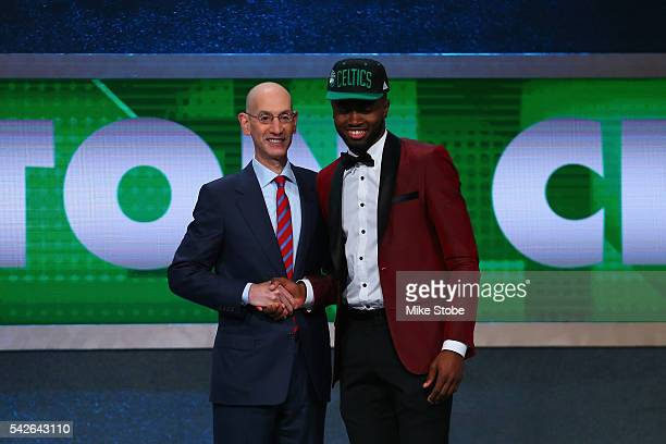 Jaylen Brown poses with Commissioner Adam Silver after being drafted third overall by the Boston Celtics in the first round of the 2016 NBA Draft at...