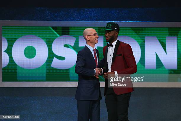 Jaylen Brown shakes hands with Commissioner Adam Silver after being drafted third overall by the Boston Celtics in the first round of the 2016 NBA...