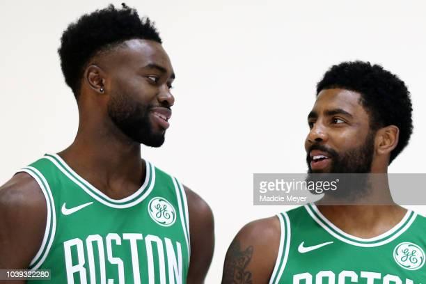 Jaylen Brown talks with Kyrie Irving during a photo shoot for Boston Celtics Media Day on September 24 2018 in Canton Massachusetts