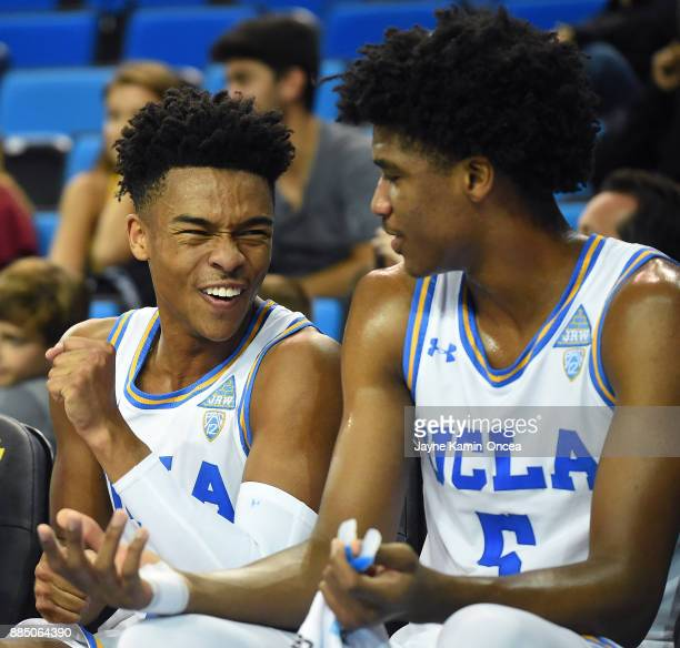 Jaylen Hands and Chris Smith of the UCLA Bruins on the bench in the second half of the game against the Detroit Mercy Titans at Pauley Pavilion on...