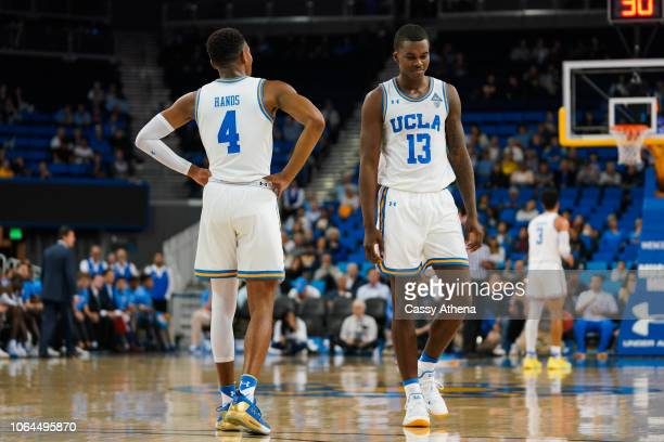 Jaylen Hands and Kris Wilkes of the UCLA Bruins talk during a free throw against the Fort Wayne Mastodons during a game at Pauley Pavilion on...