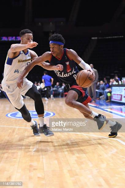 Jaylen Hands of the Long Island Nets handles the ball against Jared Cunningham of the Santa Cruz Warriors during an NBA GLeague game on December 6...