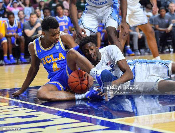 Jaylen Hands of the UCLA Bruins and Brandon Robinson of the North Carolina Tar Heels fight for a loose ball during the 2018 Continental Tire Las...