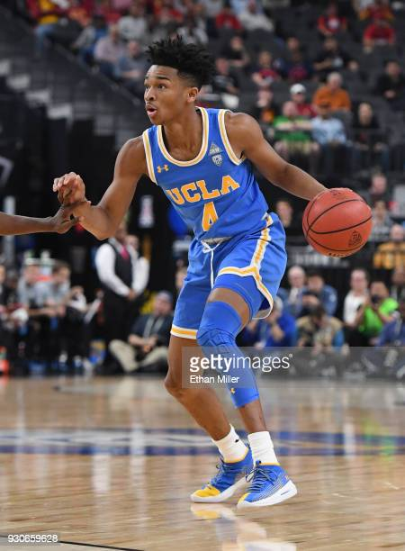 Jaylen Hands of the UCLA Bruins brings the ball up the court against the Arizona Wildcats during a semifinal game of the Pac12 basketball tournament...