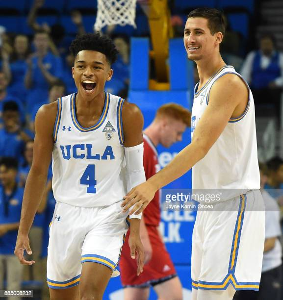 Jaylen Hands of the UCLA Bruins celebrates with Alex Olesinski of the UCLA Bruins after he stole the ball from Jack Ballantyne of the Detroit Mercy...