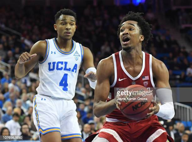 Jaylen Hands of the UCLA Bruins defends Bryce Wills of the Stanford Cardinal as he drives to the basket in the second half of the game at Pauley...