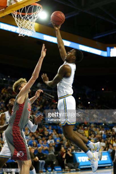 Jaylen Hands of the UCLA Bruins goes in for a layup as Jayce Johnson of the Utah Utes tries to block during the second half of a game at Pauley...