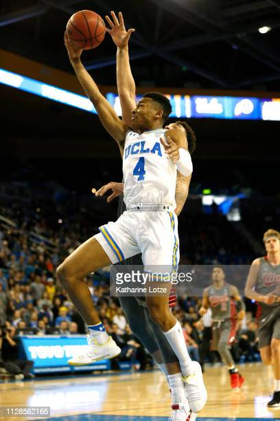 Jaylen Hands of the UCLA Bruins goes up for a shot as Timmy Allen of the Utah Utes tries to block during the second half of a game at Pauley Pavilion...