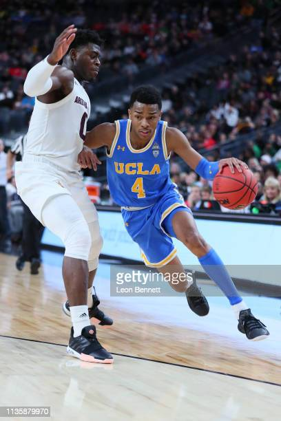 Jaylen Hands of the UCLA Bruins handles the ball against Luguentz Dort of the Arizona State Sun Devils during a quarterfinal game of the Pac12...