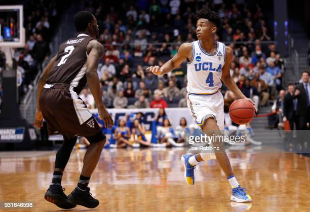 Jaylen Hands of the UCLA Bruins is defended by Matt Mobley of the St Bonaventure Bonnies during the first half of the First Four game in the 2018...