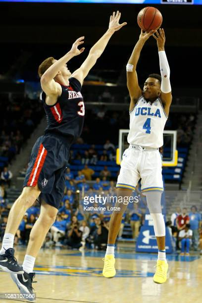 Jaylen Hands of the UCLA Bruins shoots a threepointer as Dylan Windler of the Belmont Bruins jumps to block during the second half at Pauley Pavilion...