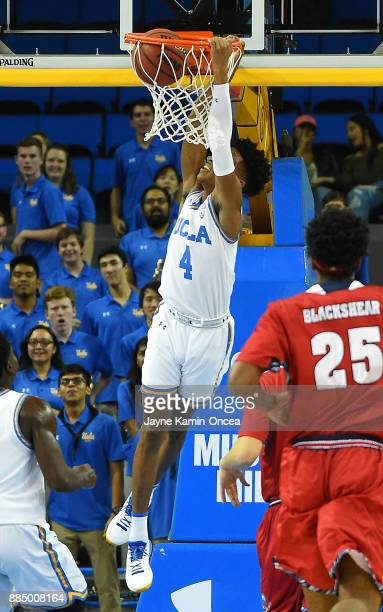 Jaylen Hands of the UCLA Bruins was called for a technical foul after hanging on the basket after a dunk in the first half of the game against...