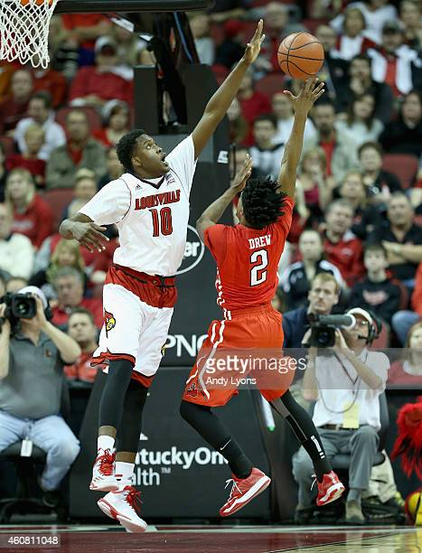 Jaylen Johnson of the Louisville Cardinals defends the shot of Landon Drew of the Cal State Northridge Matadors during the game at KFC YUM! Center on...