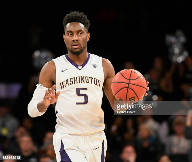 Jaylen Nowell of the Washington Huskies dribbles against the Providence Friars during the 2K Classic at Madison Square Garden on November 16 2017 in...