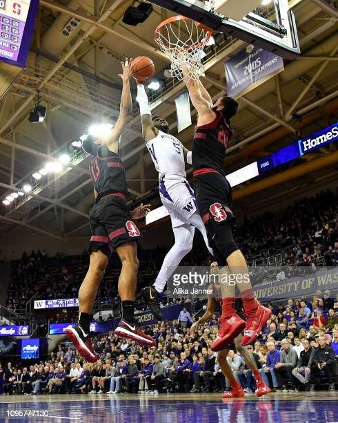 Jaylen Nowell of the Washington Huskies shoots between two Stanford Cardinal at Hec Edmundson Pavilion on January 17 2019 in Seattle Washington
