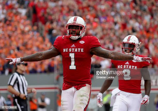 Jaylen Samuels of the North Carolina State Wolfpack reacts after scoring a touchdown against the Clemson Tigers during their game at Carter Finley...