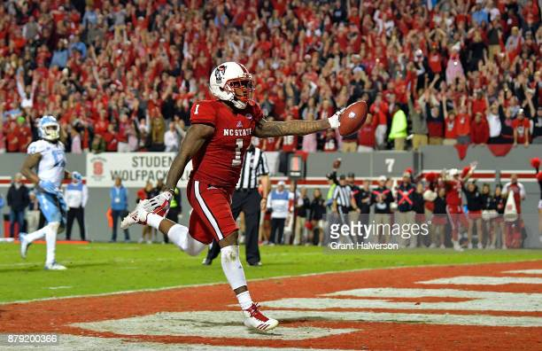 Jaylen Samuels of the North Carolina State Wolfpack scores the gameclinching touchdown late in the fourth quarter of their game against the North...