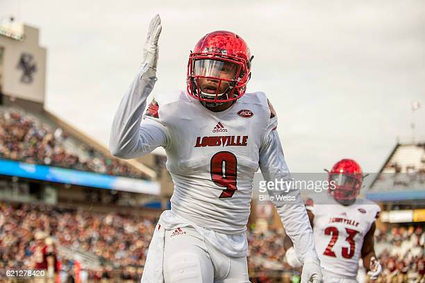 Jaylen Smith of Louisville reacts after catching a touchdown pass during the first quarter of a game against Boston College at Alumni Stadium on...