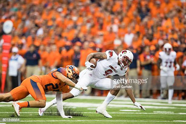 Jaylen Smith of the Louisville Cardinals carries the ball during the first half against the Syracuse Orange on September 9 2016 at The Carrier Dome...