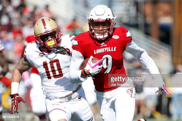 Jaylen Smith of the Louisville Cardinals runs after a catch against Ty Schwab of the Boston College Eagles in the first quarter of a game at Papa...