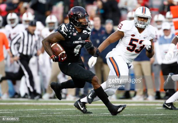 Jaylen Smith of the Louisville Cardinals runs with the ball against the Virginia Cavaliers at Papa John's Cardinal Stadium on November 11 2017 in...
