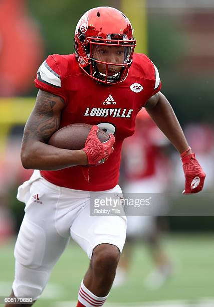 Jaylen Smith of the Louisville Cardinals runs with the ball during the game against the Florida State Seminoles at Papa John's Cardinal Stadium on...