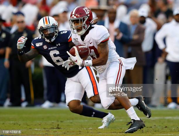 Jaylen Waddle of the Alabama Crimson Tide pulls in this reception and takes it for a touchdown against Christian Tutt of the Auburn Tigers in the...