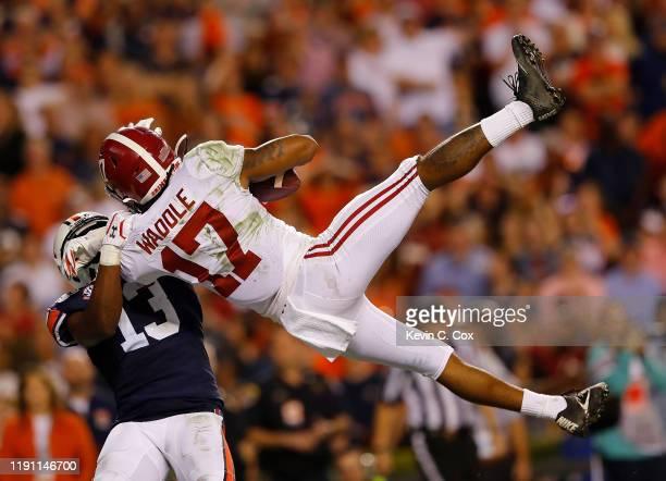 Jaylen Waddle of the Alabama Crimson Tide pulls in this touchdown reception against Javaris Davis of the Auburn Tigers at Jordan Hare Stadium on...