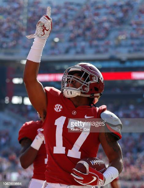 Jaylen Waddle of the Alabama Crimson Tide reacts after pulling in a reception for touchdown against the Citadel Bulldogs at BryantDenny Stadium on...