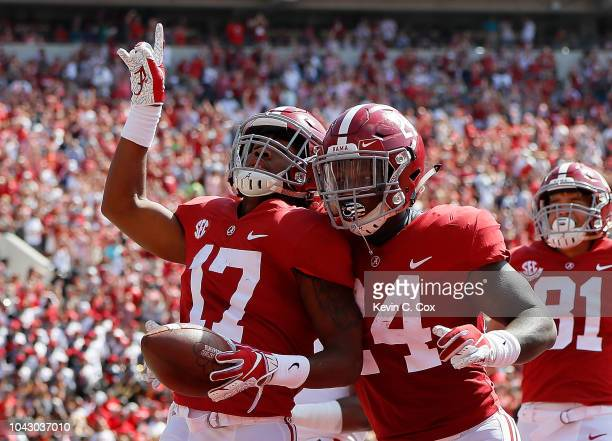 Jaylen Waddle of the Alabama Crimson Tide reacts after returning a punt for a touchdown against the Louisiana Ragin Cajuns at BryantDenny Stadium on...