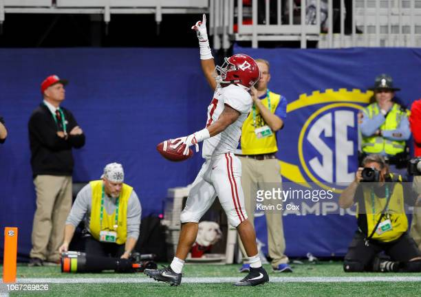Jaylen Waddle of the Alabama Crimson Tide reacts after scoring a 51yard touchdown during the third quarter against the Georgia Bulldogs during the...