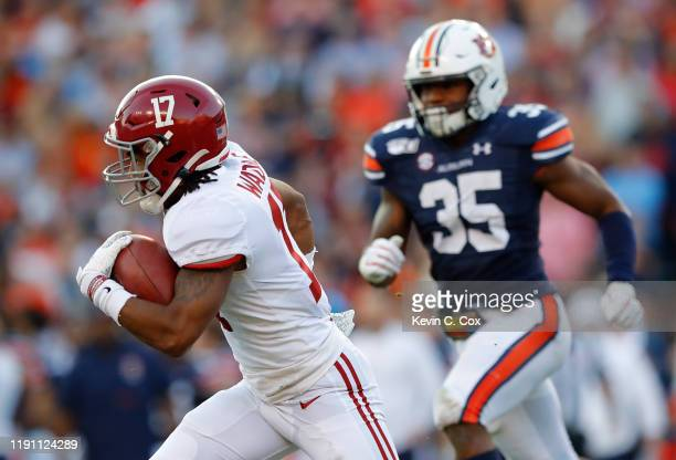 Jaylen Waddle of the Alabama Crimson Tide returns a kickoff for a touchdown against the Auburn Tigers in the first half at Jordan Hare Stadium on...