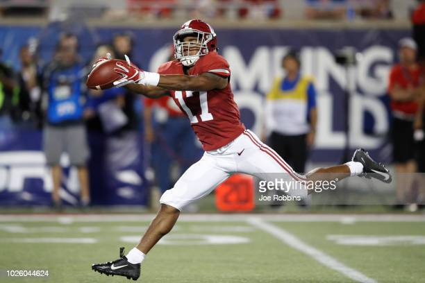 Jaylen Waddle of the Alabama Crimson Tide stretches out for a 49yard reception in the second quarter of the game against the Louisville Cardinals at...