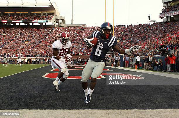 Jaylen Walton of the Ole Miss Rebels catches a touchdown pass against Landon Collins of the Alabama Crimson Tide on OCTOBER 4 2014 at VaughtHemingway...