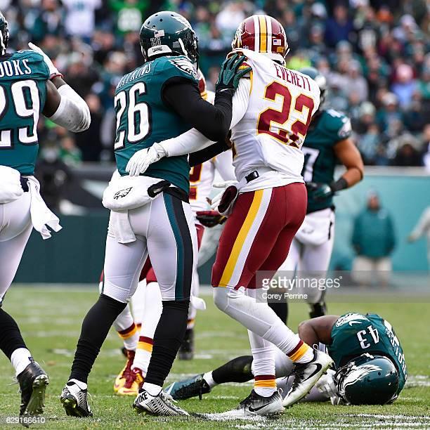 Jaylen Watkins of the Philadelphia Eagles and Deshazor Everett of the Washington Redskins look on as Darren Sproles of the Philadelphia Eagles is...