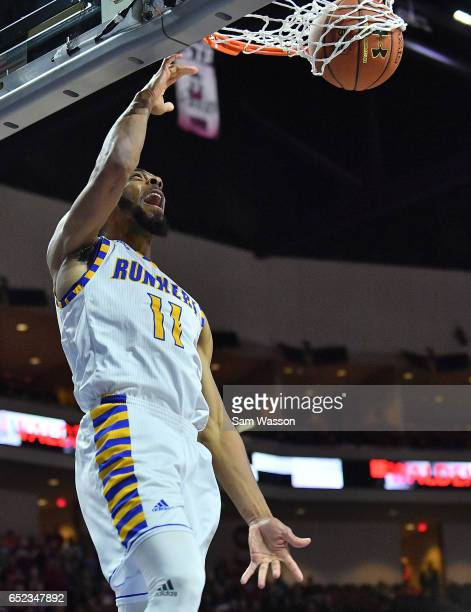 Jaylin Airington of the Cal State Bakersfield Roadrunners dunks the ball against the New Mexico State Aggies during the championship game of the...