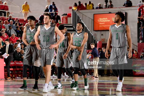 Jaylin Andrews Andrew Kostecka Chuck Champion Kenny Jones and KaVaughn Scott of the LoyolaMaryland Greyhounds take the court after a timeout against...