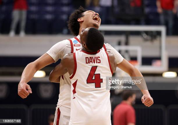 Jaylin Williams of the Arkansas Razorbacks and Davonte Davis of the Arkansas Razorbacks celebrate their 68-66 win over Texas Tech Red Raiders in the...