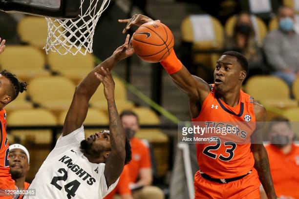 Jaylin Williams of the Auburn Tigers blocks a shot attempt by Dre Fuller Jr. #24 of the UCF Knights during a NCAA basketball game at Addition Arena...
