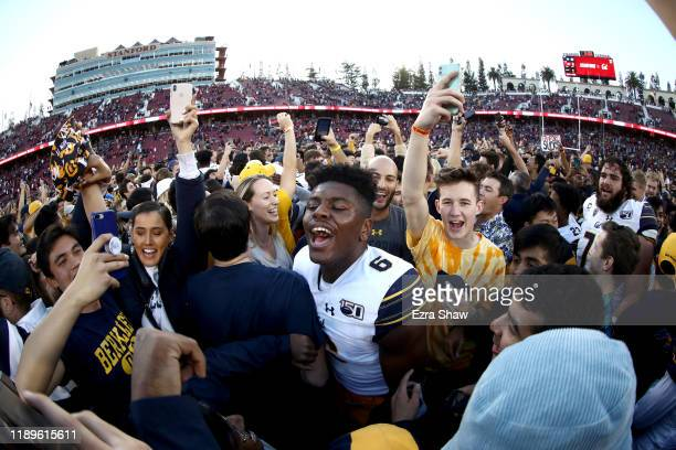 Jaylinn Hawkins of the California Golden Bears celebrates with the Cal fans after they beat the Stanford Cardinal at Stanford Stadium on November 23,...